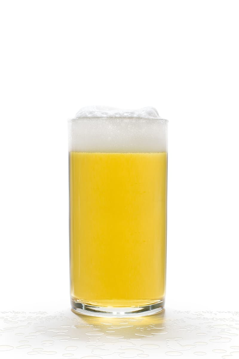 Clear highball glass filled with beverage