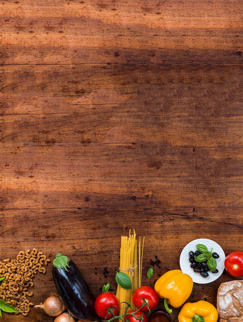 Variety of vegetables on brown wooden surface
