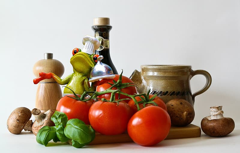 Red tomatoes and condiment containers