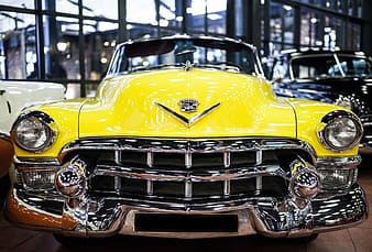 Selective focus photography of a classic yellow car