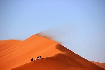 People walking on desert during daytime