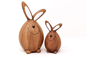 Two brown wooden animal decors