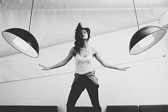 Woman flipping hair between two pendant lights