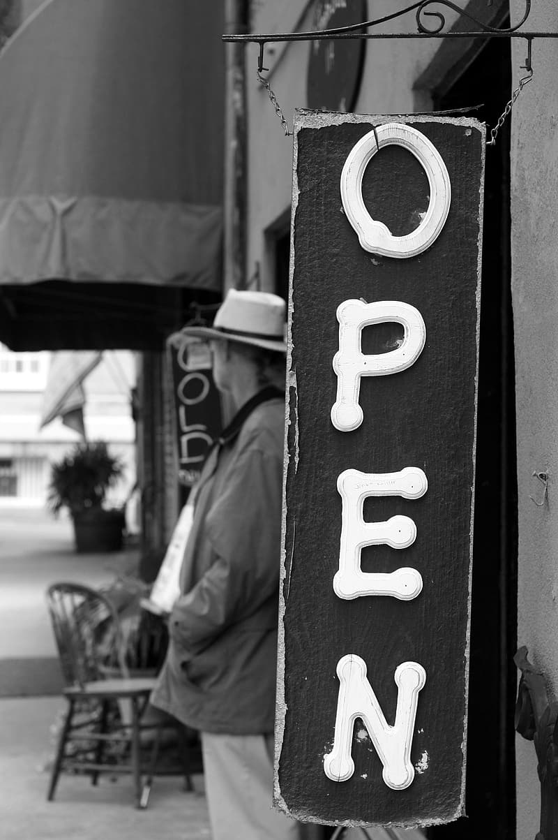 Grayscale photography of open signage