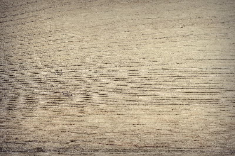 Brown wooden surface with black hair