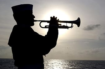 Silhouette photography of navy blowing trumpet