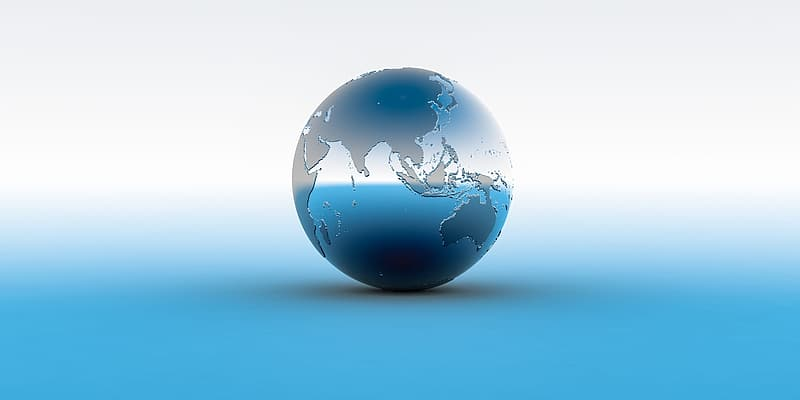 Stainless steel globe on white surface