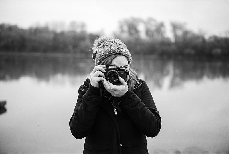 Shallow focus photography of woman taking photo