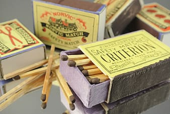 Yellow-and-black labeled matchbox