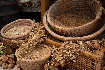 Brown wicker basket with grains
