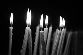 Grayscale photography of lot of candle