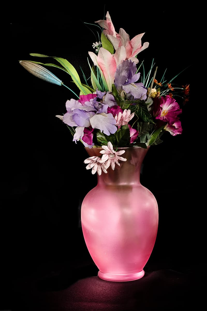 Purple and pink flowers in pink vase