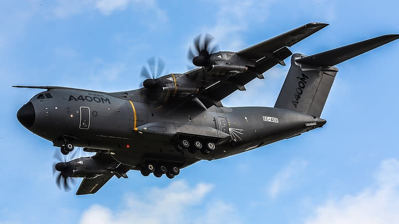 Black A400M fighter plane in the sky