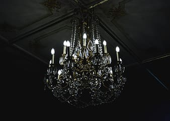 Clear uplight chandelier on gray ceiling