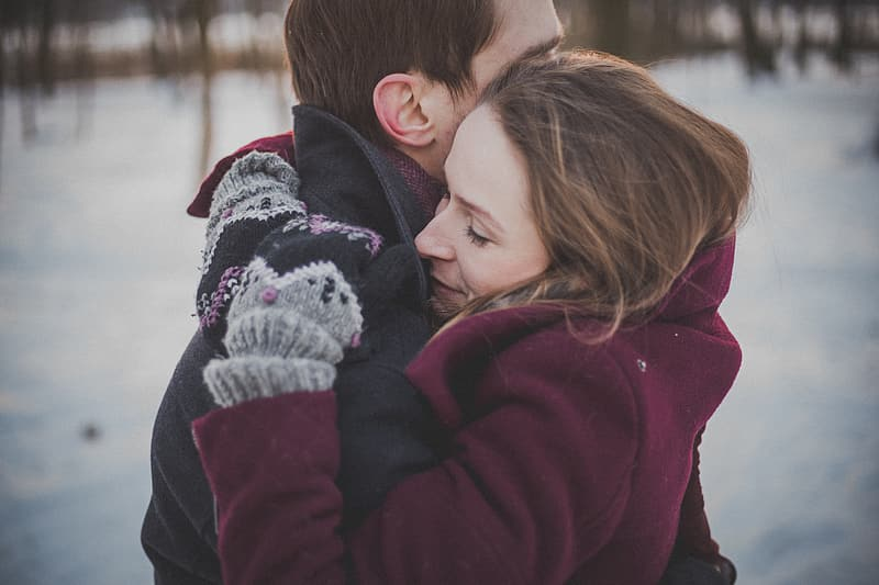 Man and woman embracing during winter