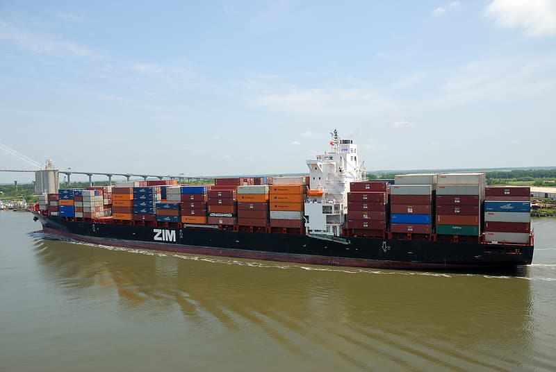 Cargo ship on body of water during daytime