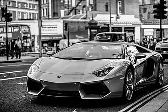 Grayscale photography of super car on road