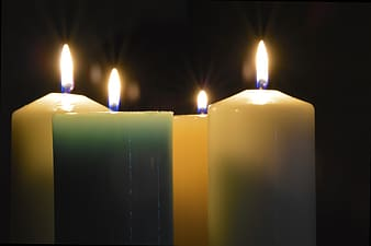 White and green lighted pillar candles