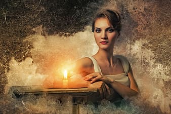 Woman in white sitting on chair with white candle