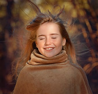 Selective focus photography of girl smiling close eyes