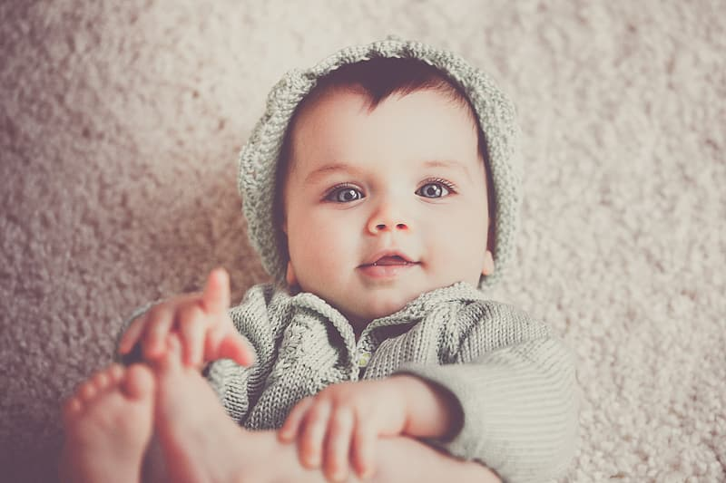 Photograph photo of baby pointing finger on fleece mat