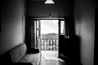 Grayscale photo of 2 beds near window