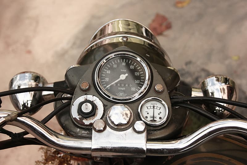 Close-up photo of black motorcycle instrument cluster panel