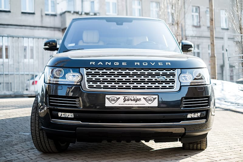 Black Land Rover Range Rover SUV on brick road at daytime