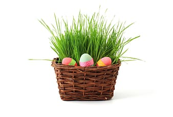 Easter eggs on brown wicker basket