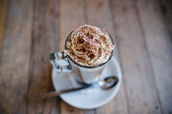 Clear glass cup with cappuccino