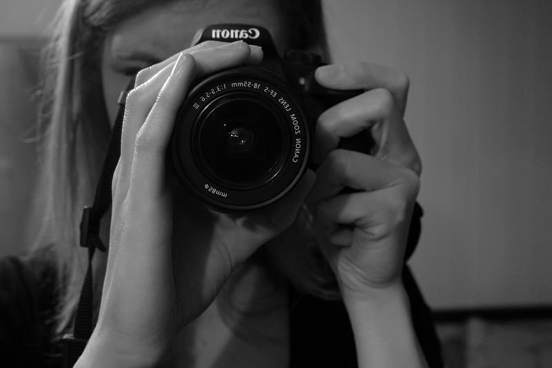 Grayscale photo of woman takes photo