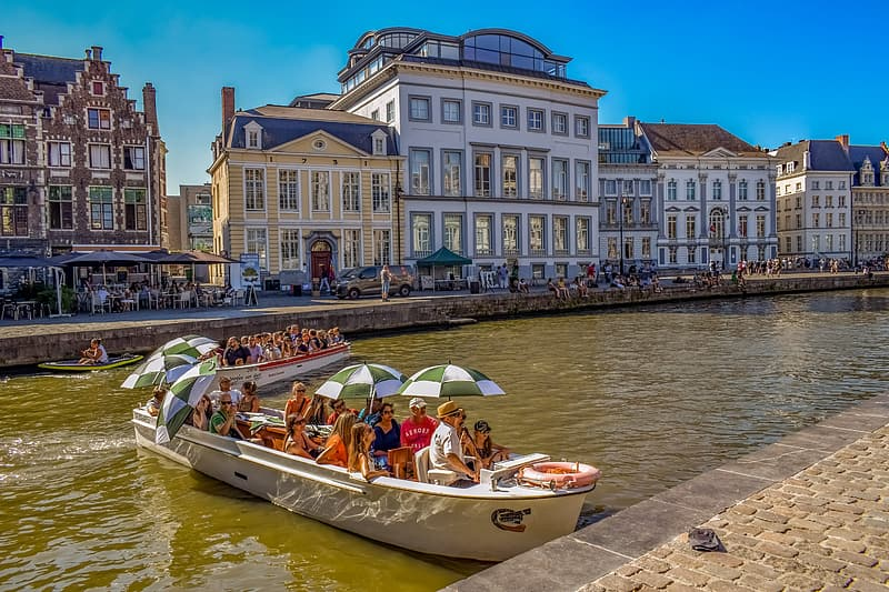 People riding on white boat on river during daytime