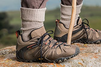 Pair of brown-and-black Merrell hiking shoes