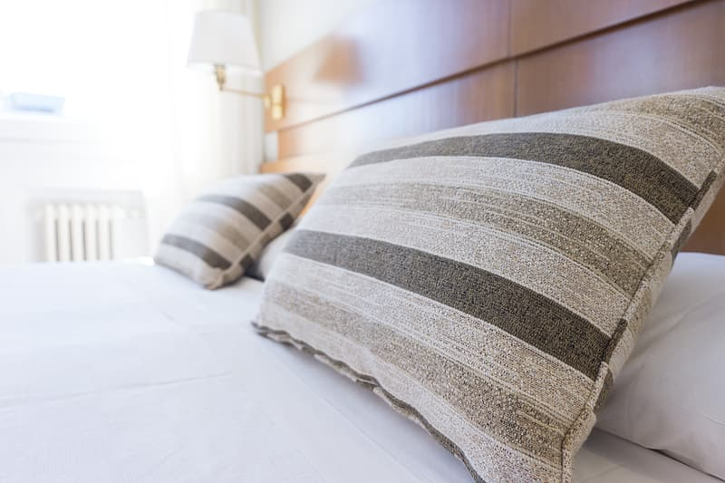 Two gray striped bed pillows