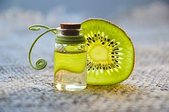 Kiwi fruit and clear glass bottle