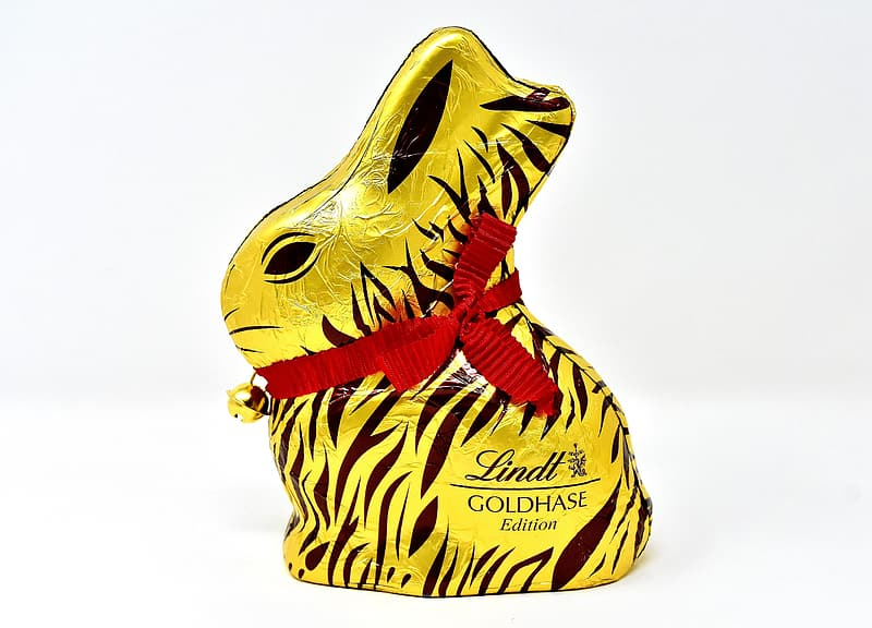 Gold and black Lindt Goldhase Edition rabbit figure on white surface