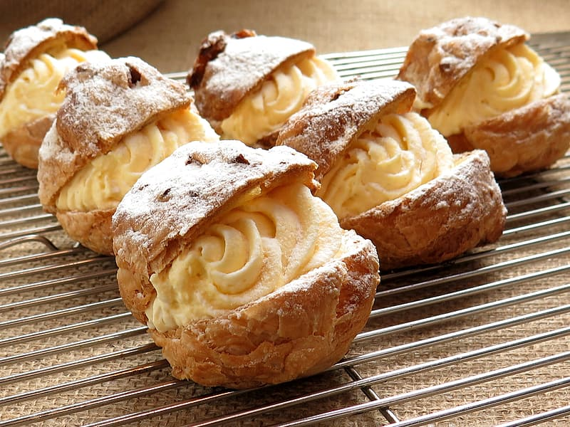 Brown pastries with white icings