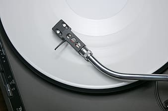 High angle view of white and gray turntable
