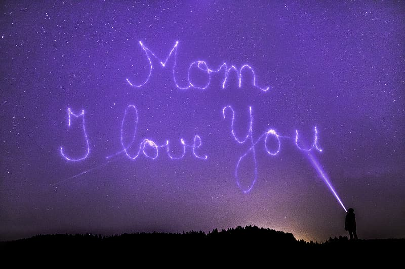 Silhouette of person standing under starry night with mom i love you text overlay