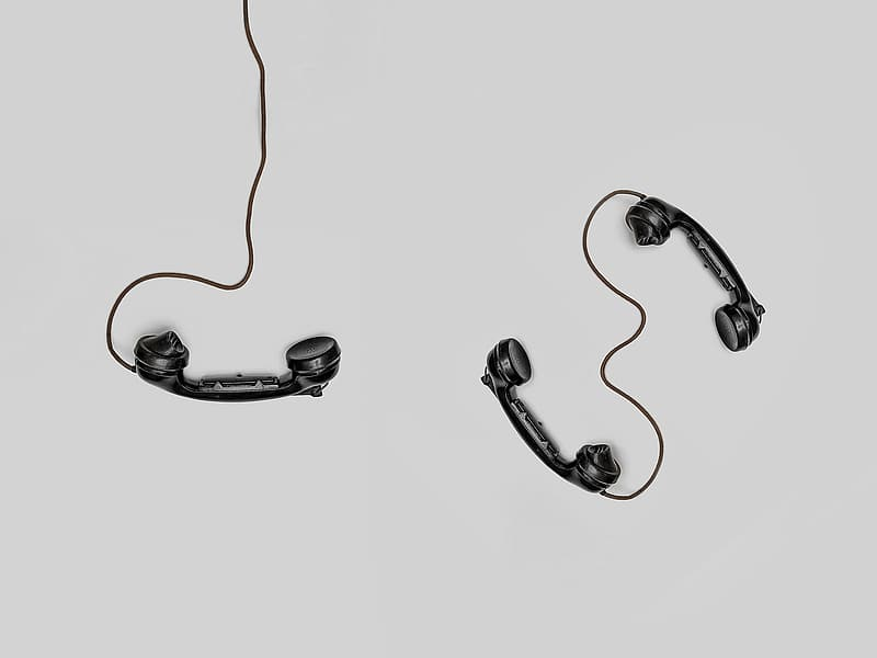 Black earbuds on white surface