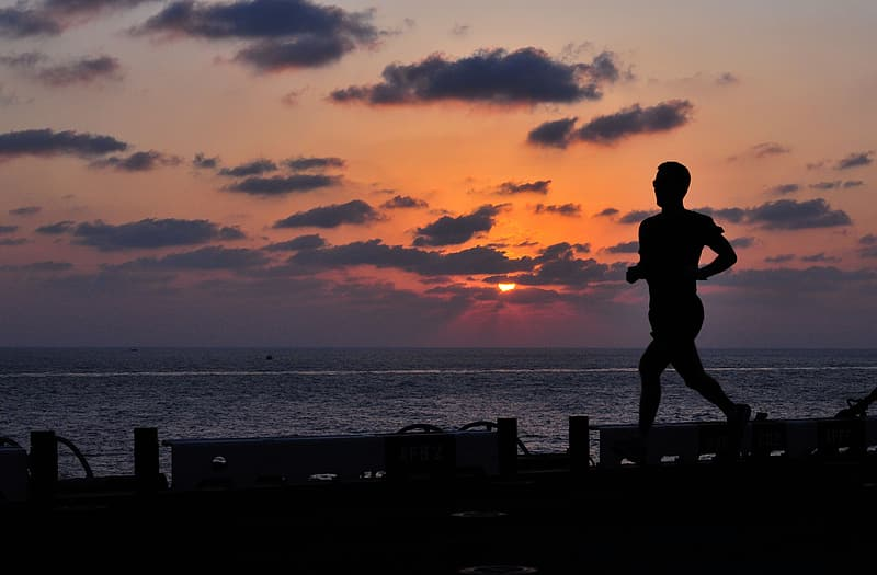 Silhouette photo of man while running