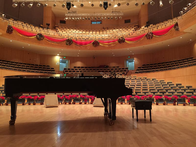 Black grand piano on stage