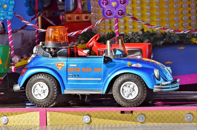 Unoccupied blue ride-on toy car