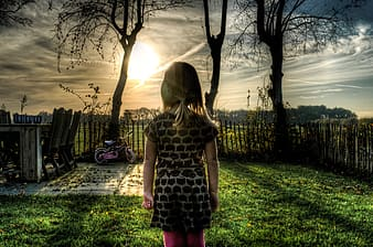 Girl standing near fence
