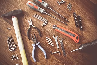 Assorted handheld tools on wooden parquet