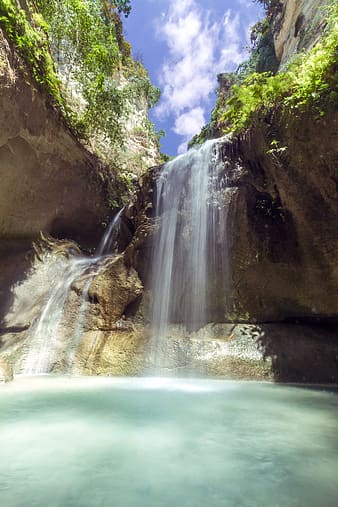 Waterfalls under blue sky photography during daytime