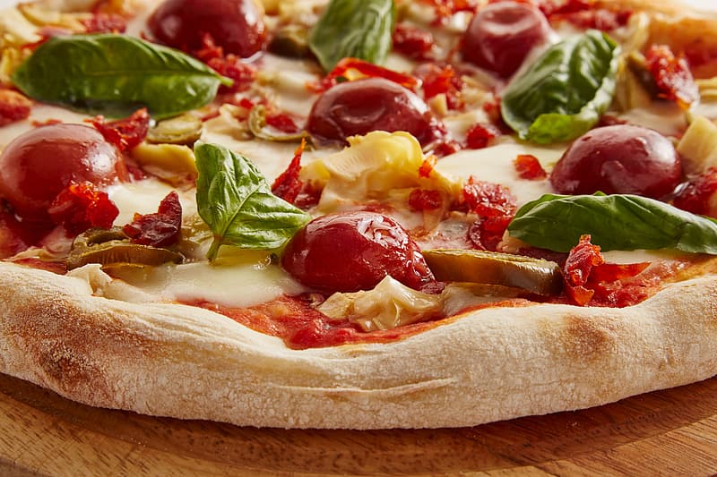 Baked pizza with spinach, cherry tomatoes and cheese