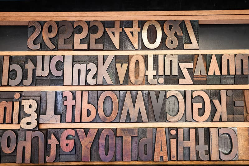 Brown wooden freestanding letters