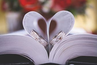 Two silver-colored rings on book page