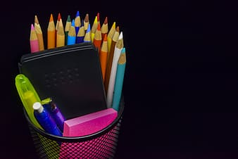 Assorted-color color pencil and pen on black metal rack